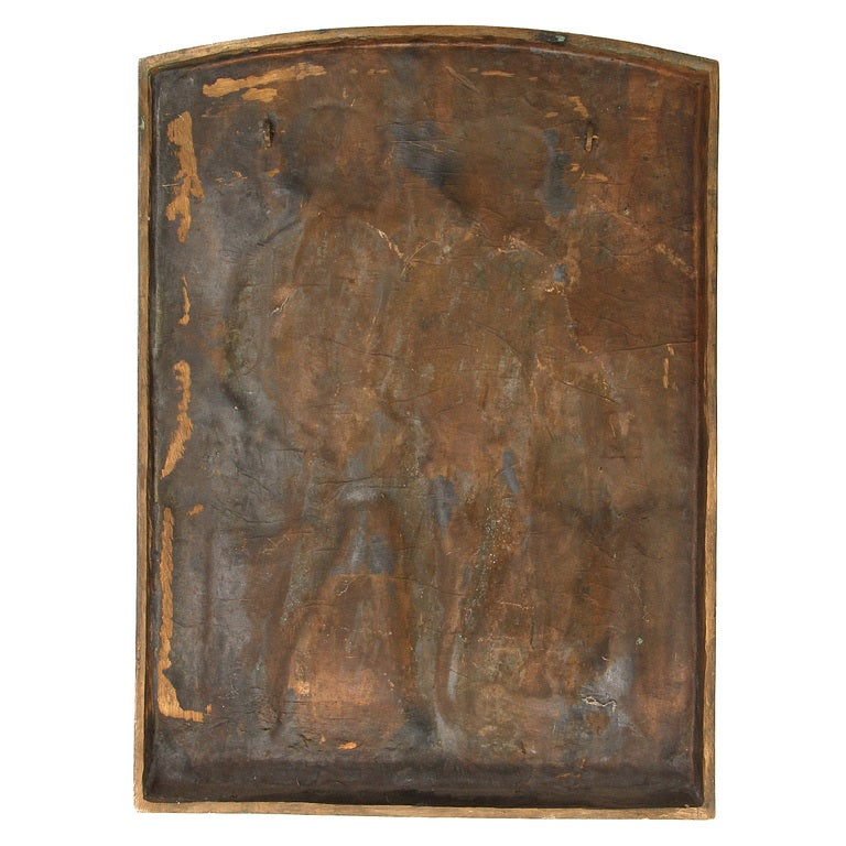 A bronze plaque of a boy and a girl in profile, seated on a bench and holding hands. Marked: April 1947 c Warner Williams Gorham Co. Founders.