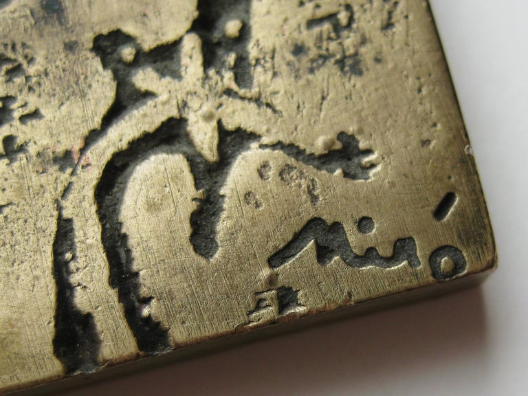 Rare and seldom seen Joan Miro bronze relief art plaque sculpture dating from 1947. Signed by the artist and features a woman with bird. Great original patina. Measures 4 3/8