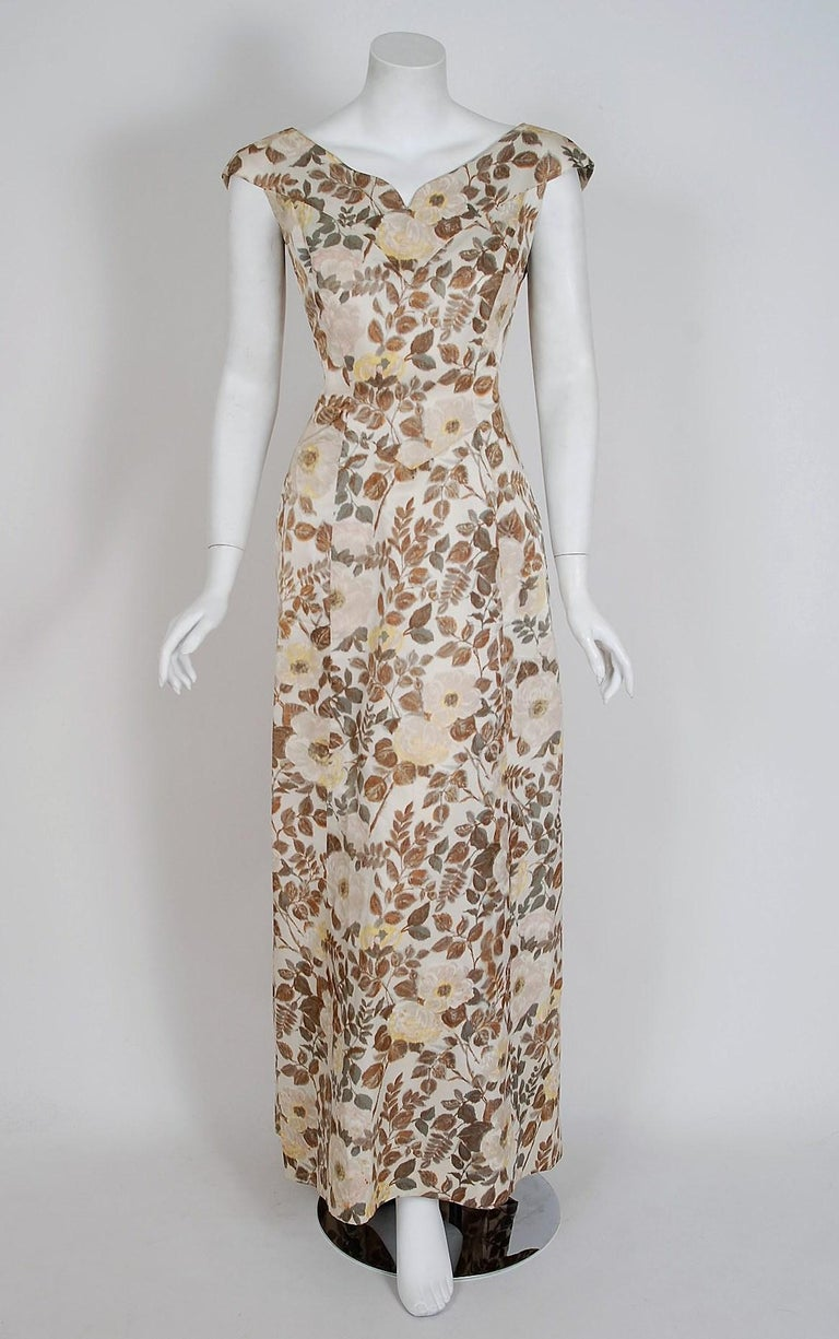 A breathtaking watercolor floral-garden silk Paquin demi-couture gown dating back to 1948. The House of Paquin was opened on the rue de la Paix in 1890 by Jeanne Paquin. The establishment was very successful and grew to be one of the largest fashion