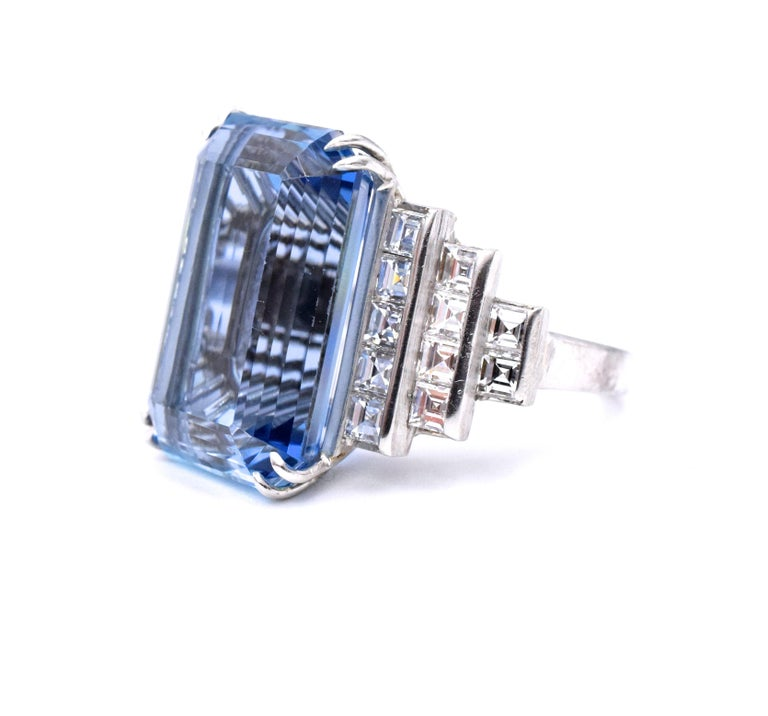 Impressive  aquamarine & diamond ring, that will make a statement anytime...Platinum  Emerald cut aquamarine is 19.49 carats with step cut mounting with 22 square cut diamonds with total weight of  totaling 2.42 CT, G - Carats set in platinum Ring