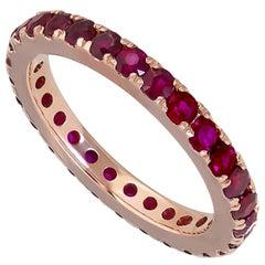 1.95 Carat Round Ruby Eternity Wedding Band in 18 Karat Rose Gold
