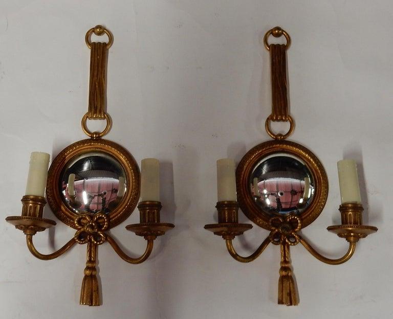 Pair of sconces with convex mirror, gilded bronze, good condition, Petitot signed, everything is screwed, circa 1950-1970 Measures: Diameter frame mirror 14 cm Diameter mirror 10 cm.