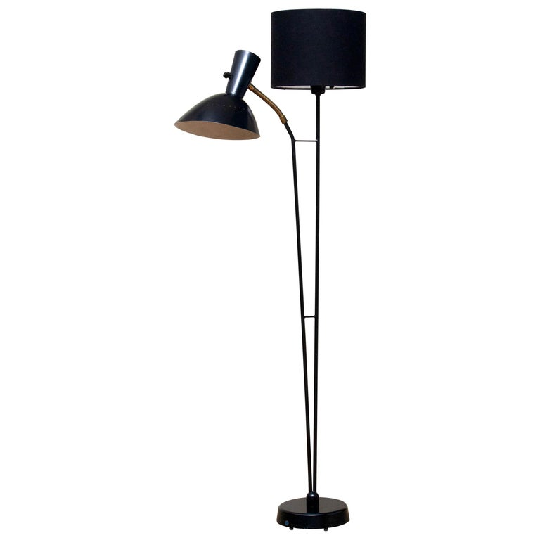 Beautiful and rare floor lamp made in the 1950s. Designed by Hans Bergström for Ateljé Lyktan in Sweden. Measures: Height 136 cm or 54 inches. Wide 60 cm or 24 inches. Technically 100% and the overall condition is good. The black fabric shade is