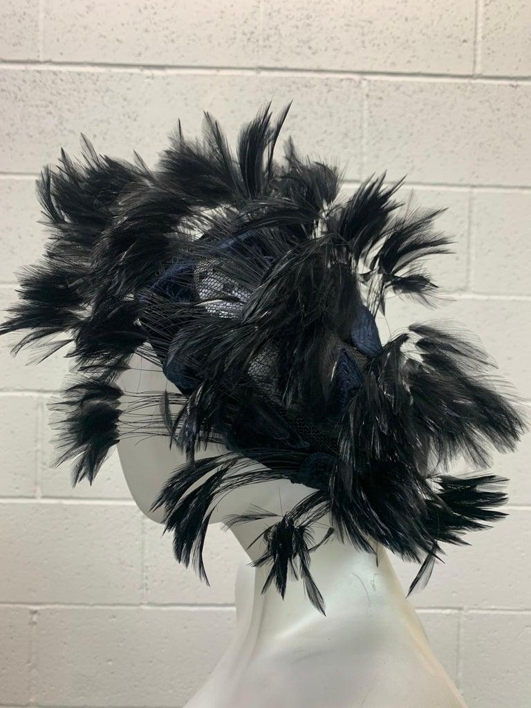 1950s Christian Dior Chapeaux black feather tufted turban with velvet triangle applique details. Satin band and a tulle structured crown are covered in applied feathers and velvet stitched triangles. Quite a striking silhouette with the wisps of