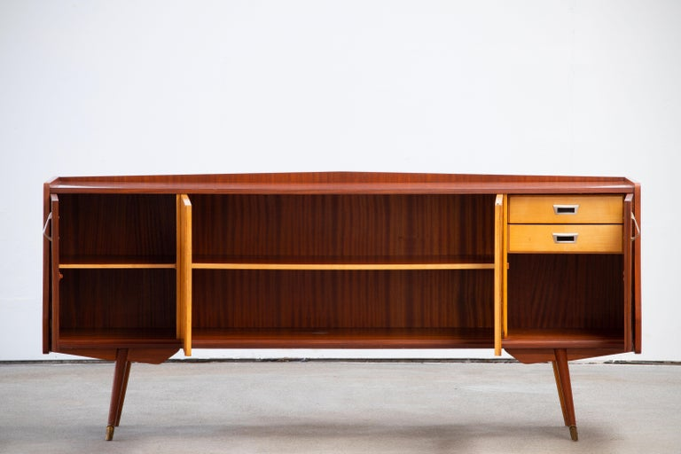 Credenza, walnut, maple, France, 1950s  This sideboard is elegant in every way. This piece is playful and airy.