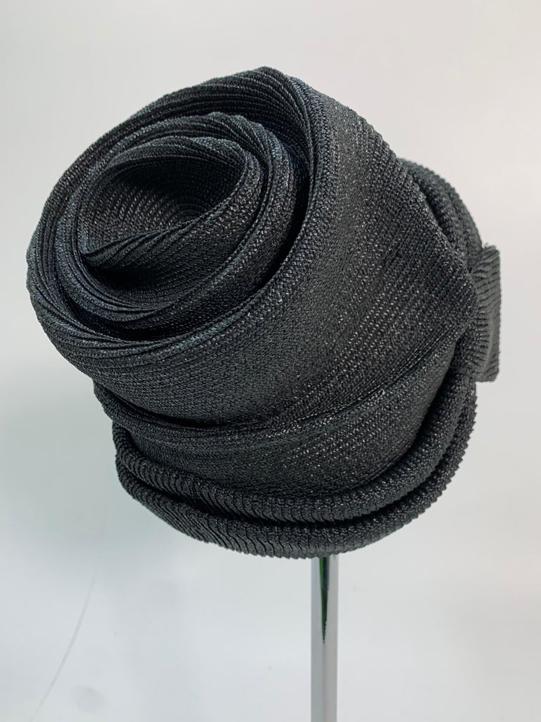 A fabulous 1950s John Frederics black straw sculpted, ruched and draped Avant Guarde, Sunset Boulevard-style hat!  A seriously unique style statement! Styled to be worn at the crown with hairline visible.