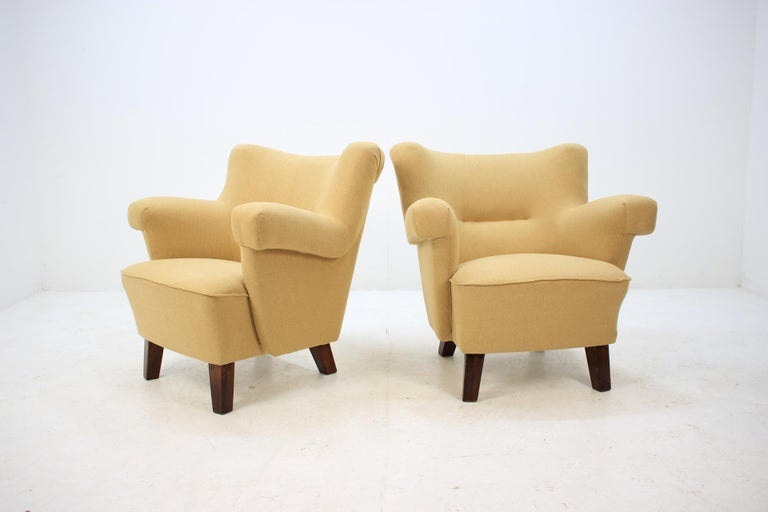 New fabric upholstery. Re-polished stained beech legs. Very comfortable.