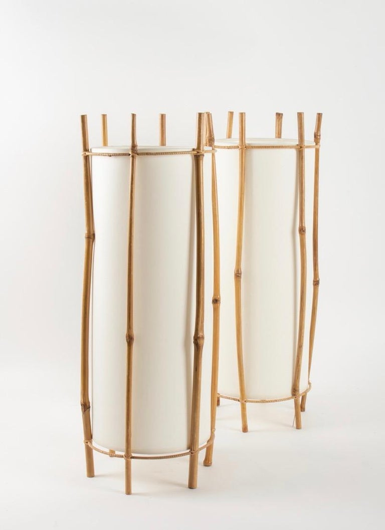 1950 large pair of table lamps Louis Sognot Each lamp consists in six bamboo stems. Cylindrical shaped lamp shade made of white cotton. One bulb per lamp.