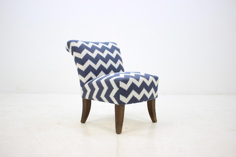 New fabric upholstery. Beech stained legs.
