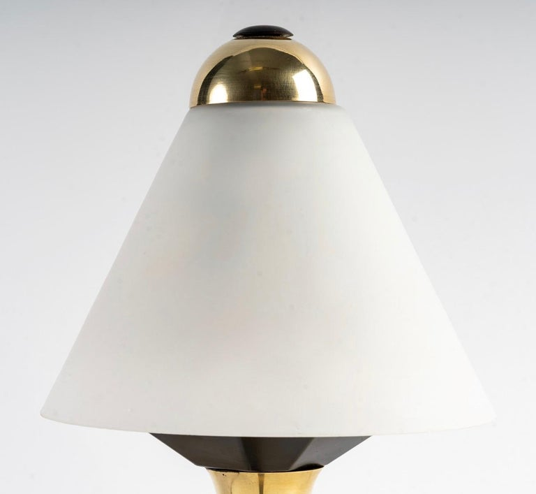 1950 pair of Maison Stilnovo lamps.  Composed of a gilt bronze tripod base. On top of the base is placed a flared barrel in gilded brass highlighted by a black part on the top. It is dressed in an original trapezoidal opaline retained on the