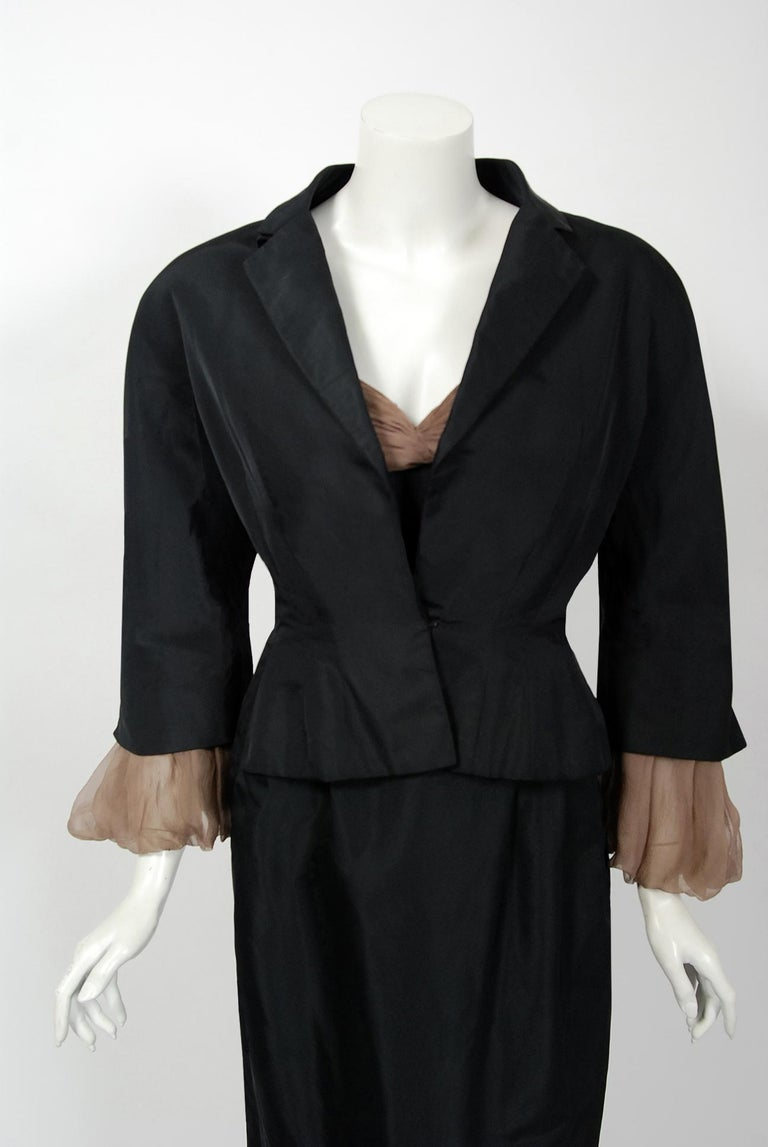 Gorgeous Pierre Balmain black silk and nude chiffon hourglass cocktail dress dating back to his 1950 collection. Balmain created a very sculptural quality which was always allied with a ladylike essence. His garments have a body and a shape of their