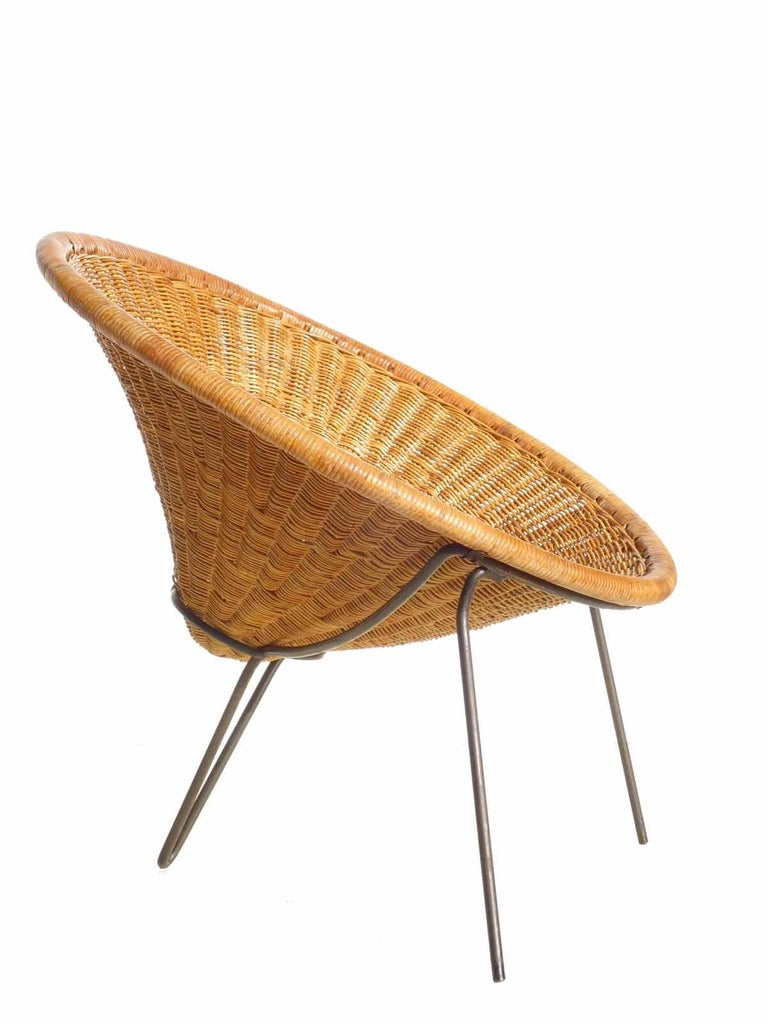 Wicker seat and black metal frame Excellent condition.