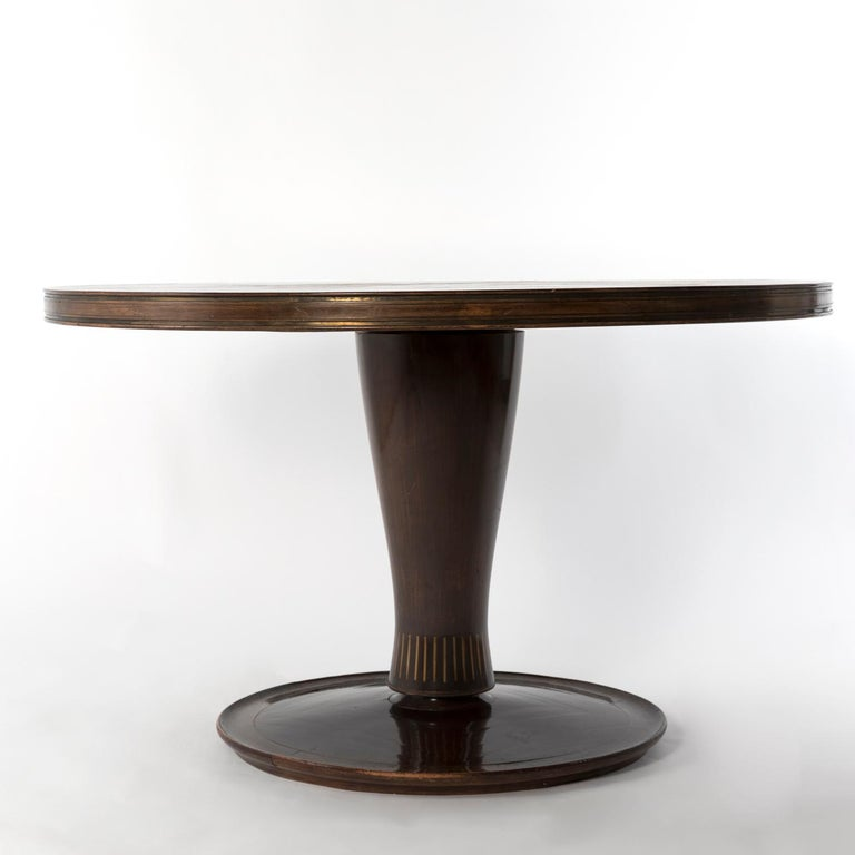 1950 dining table designed by Giovanni Gariboldi for Colli, Turin. Made from Bubinga wood and inlayed brass, it comes from a private commission in Turin. This piece could be delivered after a professional restoration by adding 1000€ to listed