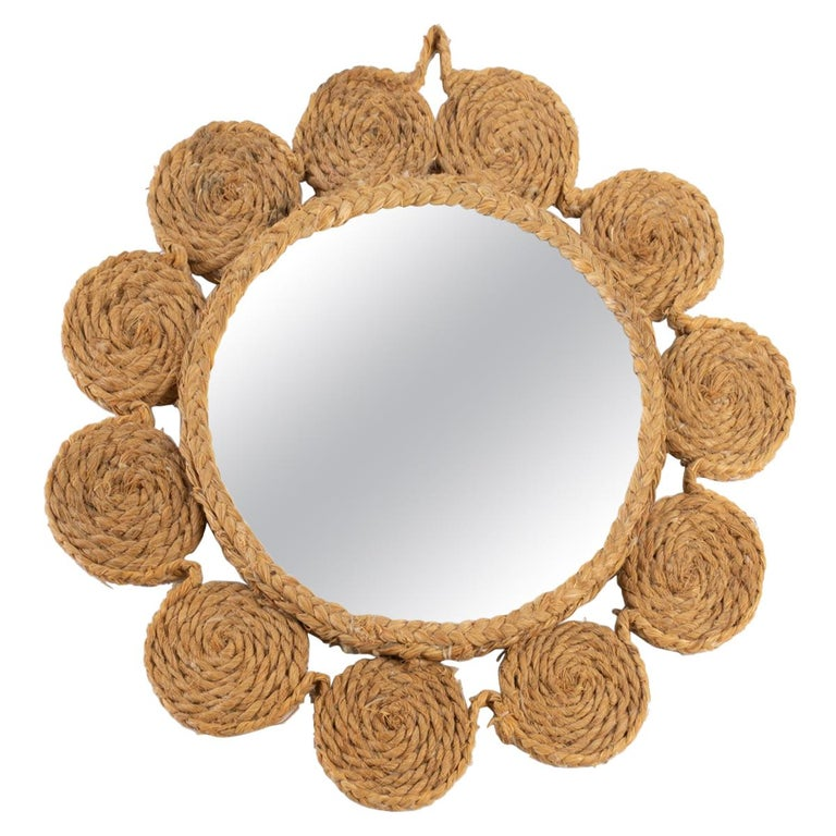 Round mirror dressed in an entourage of rope sewn together forming small circles nicely marrying the environment of the mirror.  Adrien Audoux and Frida Minet are known for their rope lights and furniture. Their first workshop has been founded in