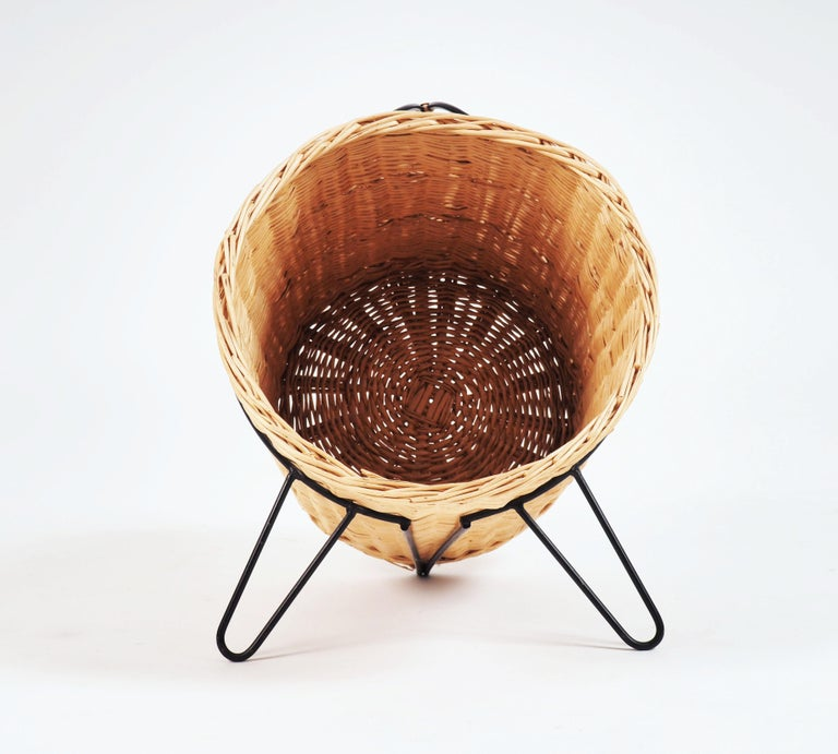 Basket for firewood or magazines in painted metal and rattan. Made in Sweden during the 1950s.