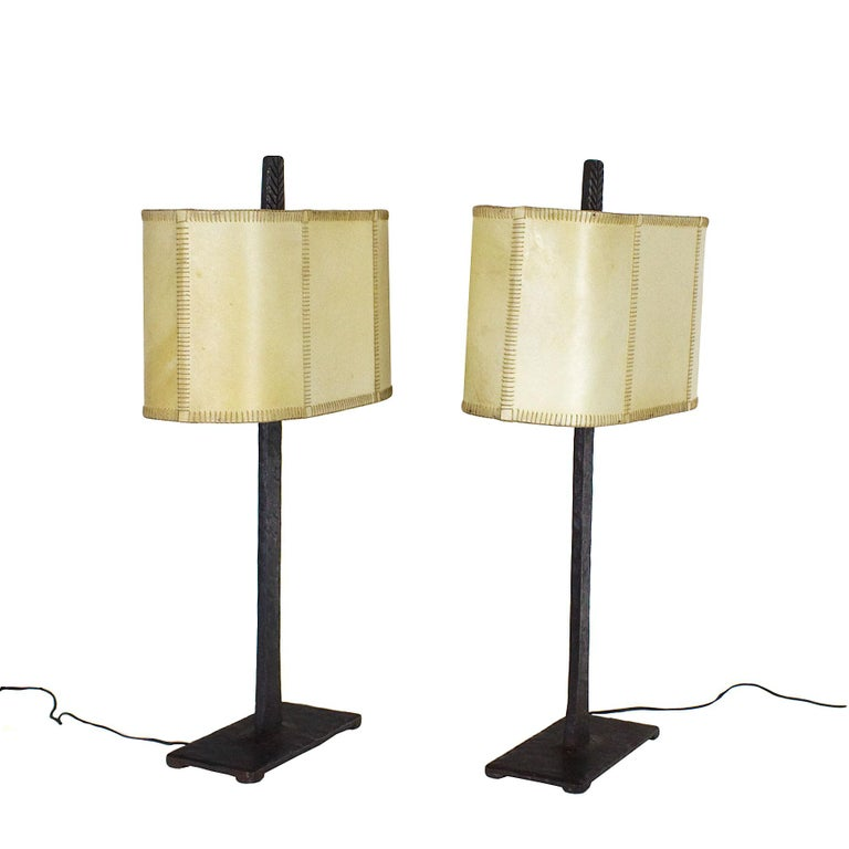 Splendid pair of table lamps, wrought iron and original parchment lampshades.  Spain, Barcelona, circa 1950.