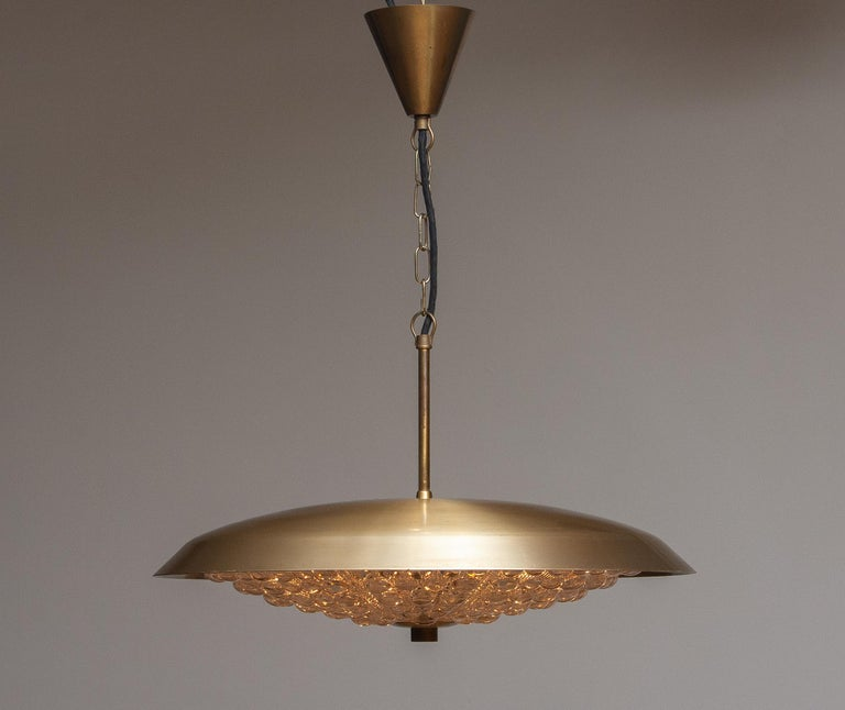 Swedish 1950s, 1 Brass and Glass Ceiling Lamp Designed by Carl Fagerlund for Orrefors