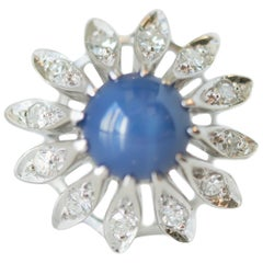 1950s 1 Carat Blue Star Sapphire, Diamond and 14 Karat White Gold Floral Ring