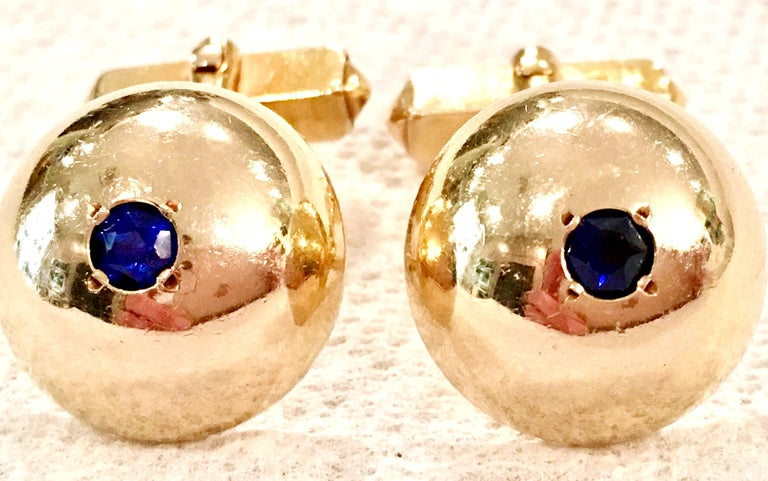 Mid-Century Pair Of Large 12-Karat Gold Filled Dome & Sapphire Blue Glass Cuff Links By, Swank. Each cuff link is signed on the underside, Swank, 1/20- 12K G.F.