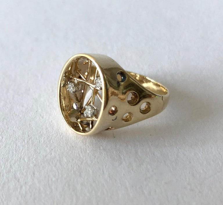 14K gold and diamond atomic sputnik ring, circa 1950s.  Ring is a finger size 5 and could be resized by a competent jeweler if need be.  An interesting alternative to a modern day engagement ring or otherwise. In very good vintage condition. 5.8