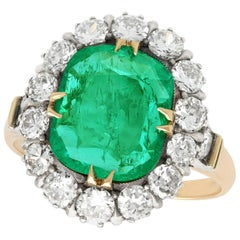 1950s 1.74 Carat Emerald and Diamond Yellow Gold Cluster Ring