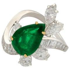 1950s 3.23 Carat Emerald and 3.91 Carat Diamond Platinum Cocktail Ring