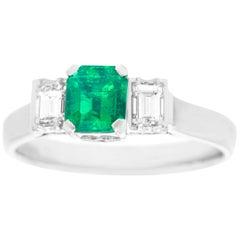 1950s .56 Carat Emerald and Diamond-Set Platinum Ring