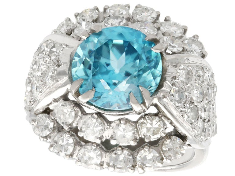 A stunning vintage 5.70Ct high zircon and 3.15Ct diamond, 18k white gold dress ring; part of our diverse vintage jewelry and estate jewelry collections.  This stunning, fine and impressive blue zircon ring has been crafted in 18k white gold.  The