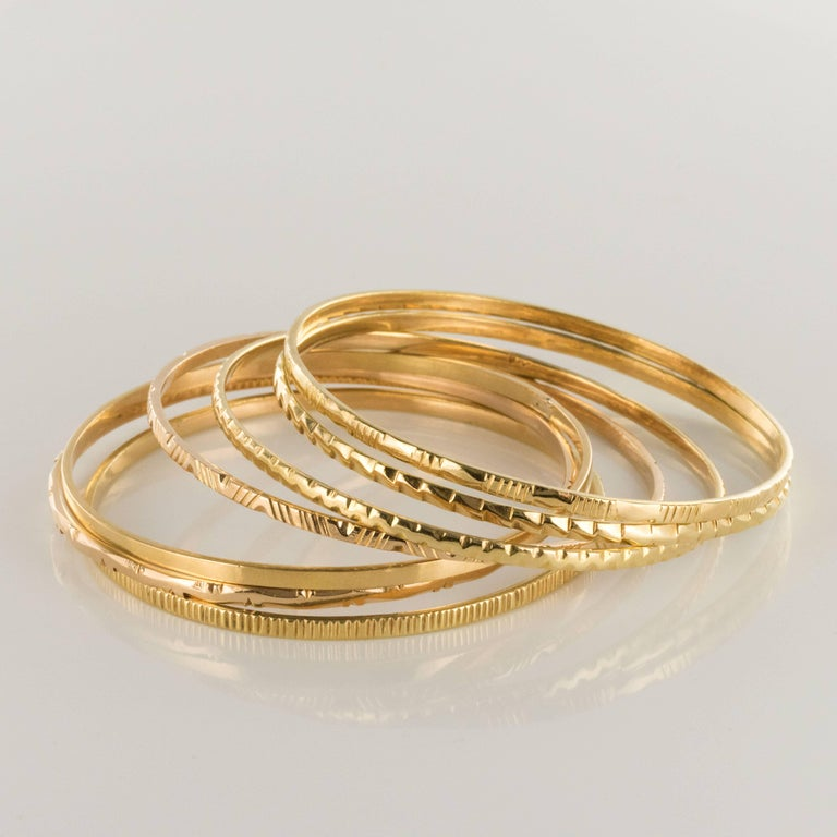 1950s 7-Day 18 Karat Yellow Gold Bangle Bracelet In New Condition For Sale In Poitiers, FR