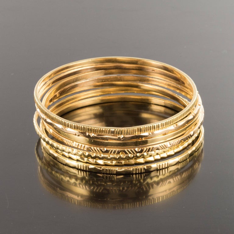 Women's 1950s 7-Day 18 Karat Yellow Gold Bangle Bracelet For Sale