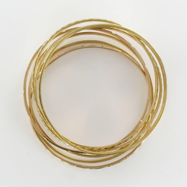 1950s 7-Day 18 Karat Yellow Gold Bangle Bracelet For Sale 2