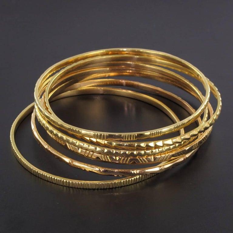 1950s 7-Day 18 Karat Yellow Gold Bangle Bracelet For Sale 4