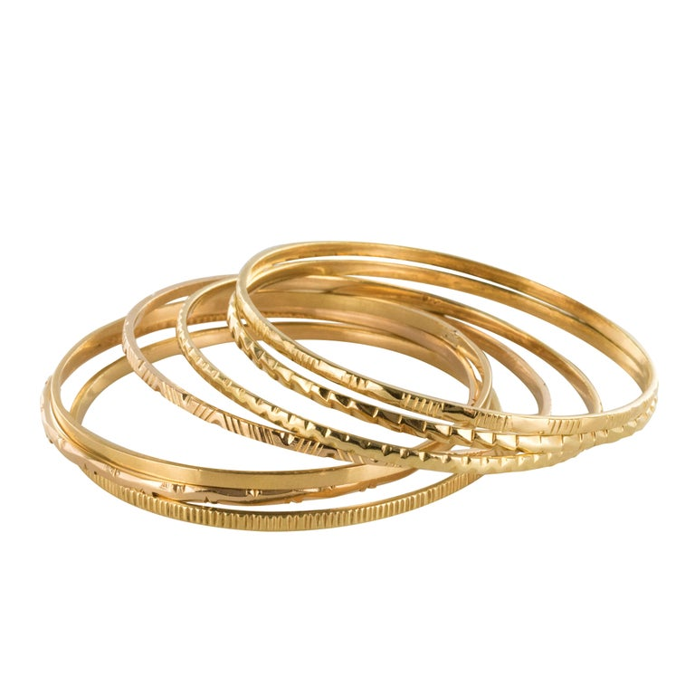 1950s 7-Day 18 Karat Yellow Gold Bangle Bracelet For Sale
