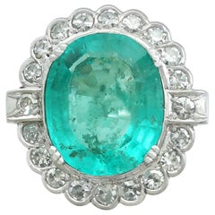 1950s 8.19 Carat Emerald and 1.48 Carat Diamond White Gold Cocktail Ring