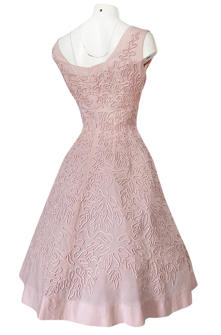 This Adele Simpson dress is rather exceptional. It is made out of a pale pink cotton that in person is an even prettier shade of pink then how the camera captured it. It is sleeveless and the neckline is scooped at both the front and back of the