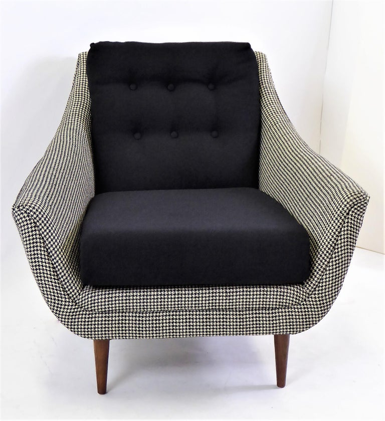 Lovely 1950s styling highlight this Adrian Pearsall lounge chair. Now upholstered in a houndstooth weave and a black tight hopsack weave. Great tapering walnut legs. A comfortable scoop styling.