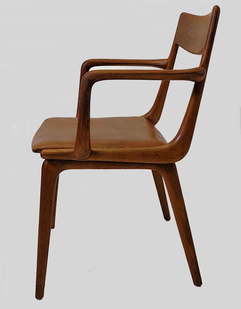 Danish boomerang armchairs in teak by Alfred Christensen for Slagelse Møbelfabrik.  The comfortable armchairs feature a simple but elegant boomerang shaped frame in solid bended teak with a well-shaped teak backrest and a very comfortable seat.  The