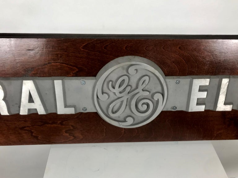 1950s aluminum on wood General Electric logo, sign plaque. Salvaged from General Electric Buffalo NY office, stunning, original plaque, cast aluminum depicting famous G E Logo, mounted on wood.