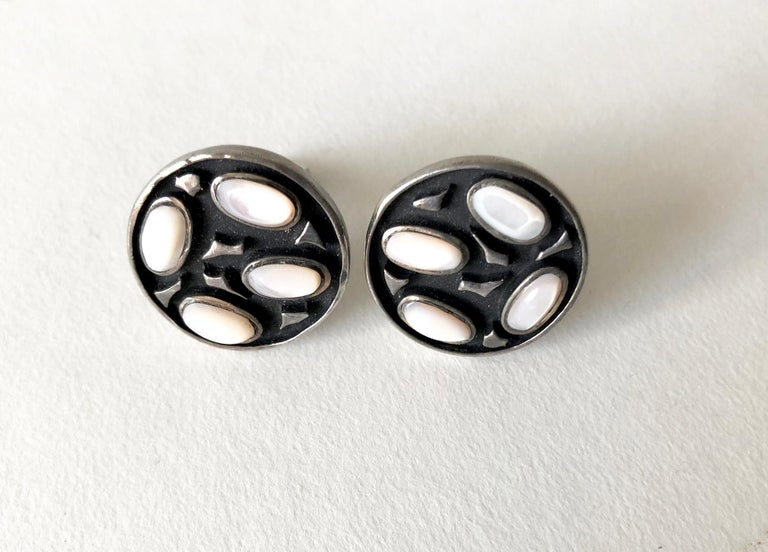 Well crafted American modernist sterling silver and mother of pearl cufflinks, circa 1950's.  Cufflinks measure 7/8