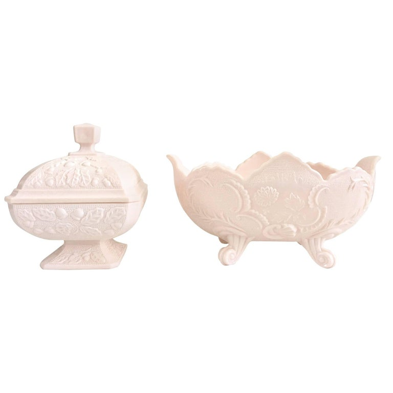 Midcentury set of two pieces American pink milk glass, lidded candy dish and footed oval bowl.