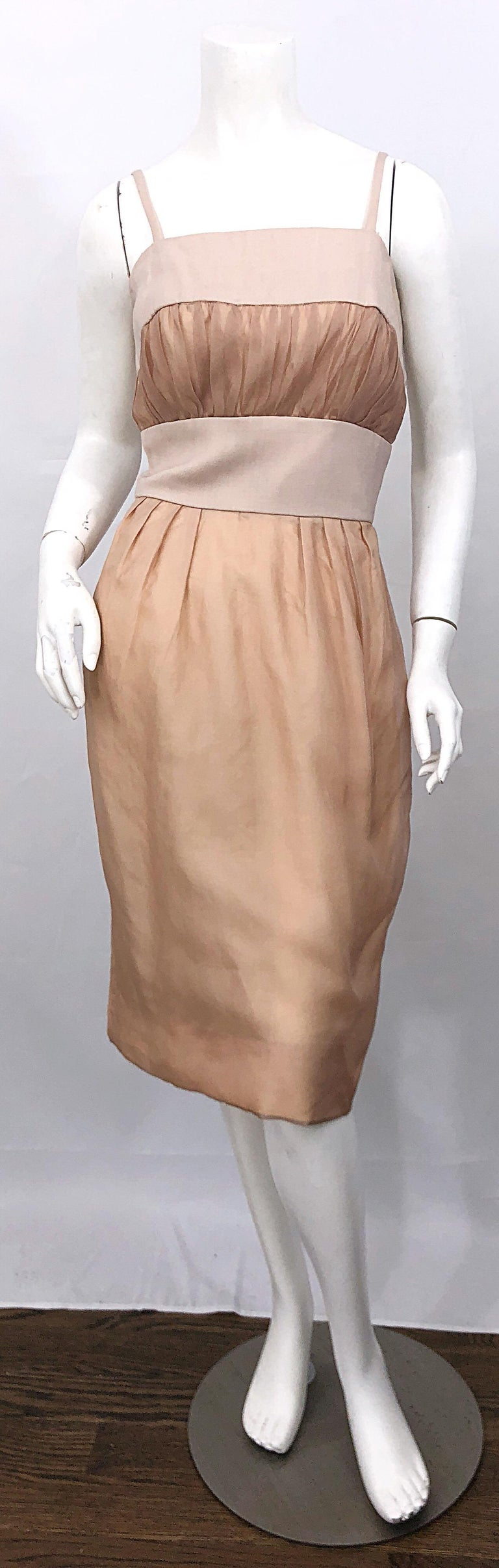 Beautiful 1950s ANITA MODES demi couture nude blush silk bombshell dress! Features a nude silk base with sheer chiffon overlay. Linen waistband, each shoulder strap, and above the bodice. Puckered chiffon at bust is so intricate, and very