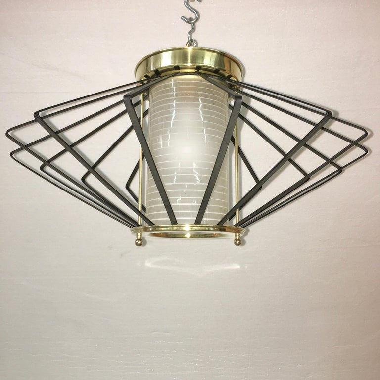 Original vintage ceiling mounted fixture perfect for entrance hall made by Gill Glass & Fixture Co of Philadelphia. Etched glass cylinder between two solid brass rings within a steel cage of midcentury molecular/atomic form. Takes a single Edison