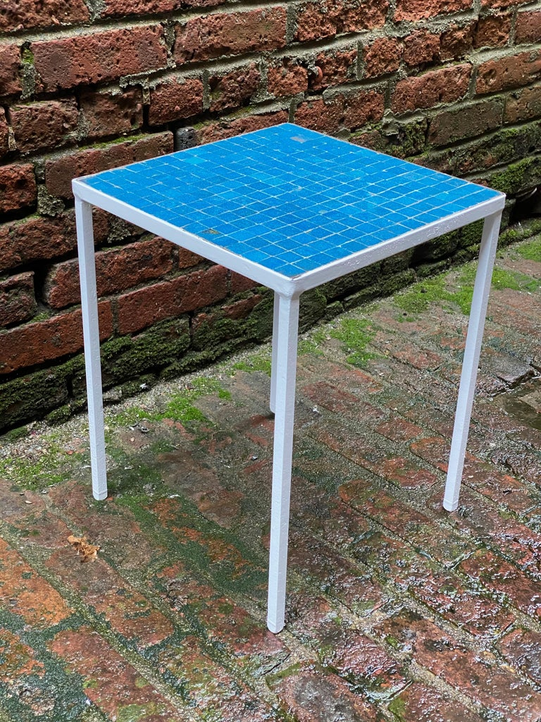 Vibrant blue glass tile table with an iron base. Italian glass tiles, circa 1950-60. Good overall condition with some flawed and chipped tiles.