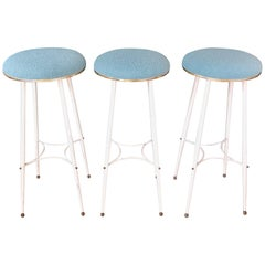 A set of 3 Midcentury Bar Stools, White Metal, Brass and Pastel Blue Upholstery