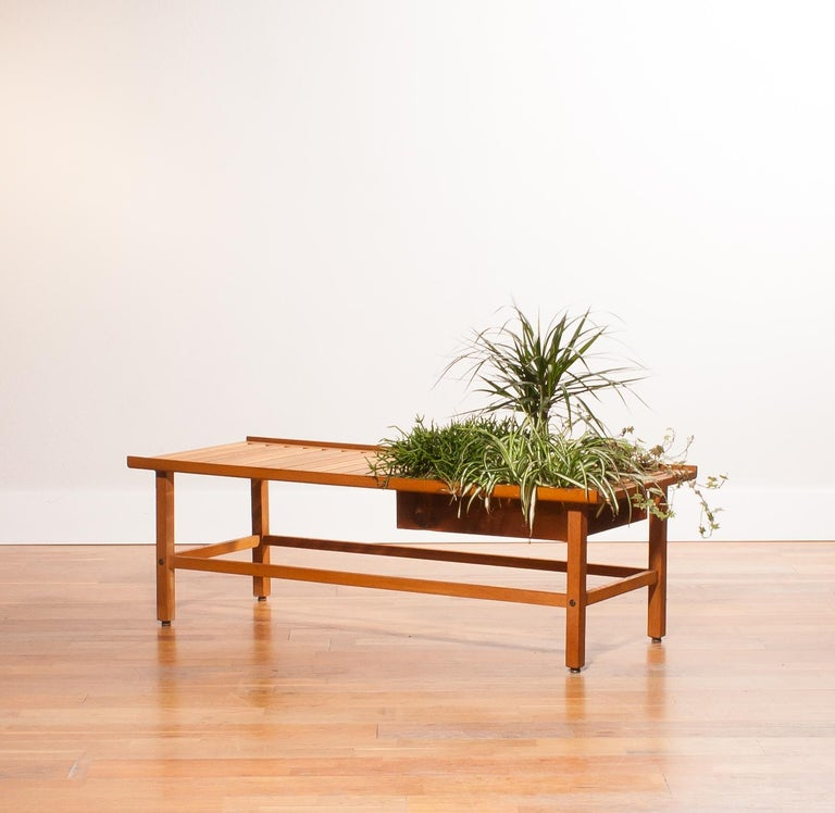 A beautiful plant bench designed by Yngve Ekström. The bench is made of teak. There is room for plants of flowers in the copper compartment. It is in excellent condition. Period 1950s. Dimensions: H 39 cm, D 48 cm, W 120 cm.