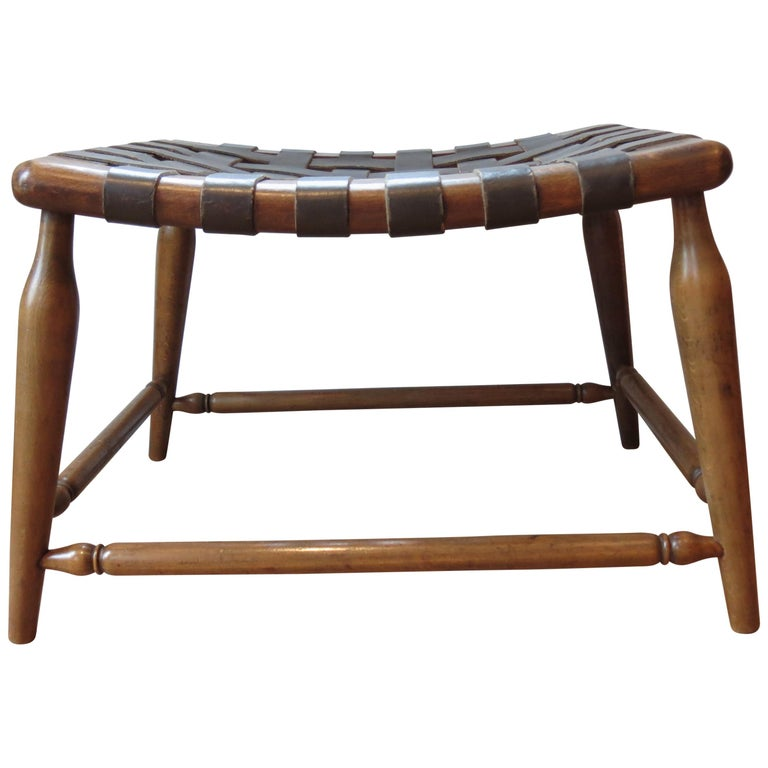 Wonderful wooden stool with leather strap seat, dates from the 1950s. Made from solid beech with brown leather strap seat. In good vintage condition. Some wear and patination to the leather seat. ST1274.