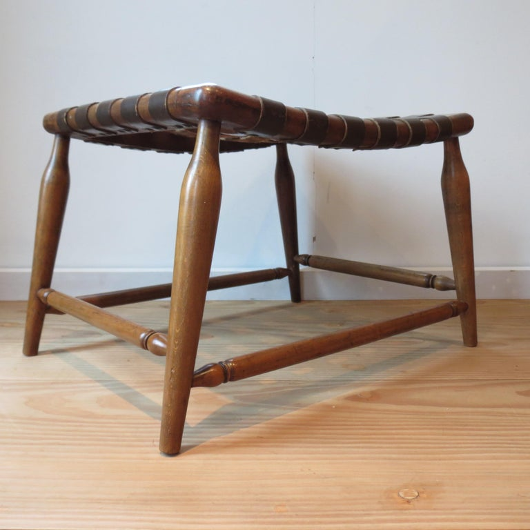 English 1950s Beechwood and Brown Leather Strap Wooden Stool For Sale