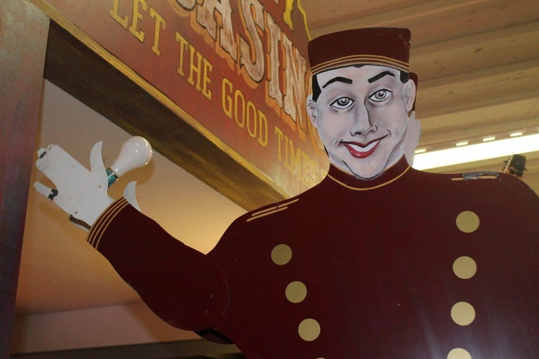 This is a Lighted Bellhop National Animated Sign Co. double-sided that is Manufactured by National Animated Co. These bellhop signs were developed in the late 1940s and patented in 1951 by the National Animated Sign Co. of Hot Springs, AR. These