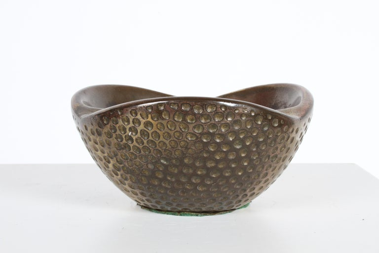 Sculptural brass ash tray designed by Ben Seibel for Jenfred-Ware. Biomorphic shape with golf ball like hole pattern. Patina from use.