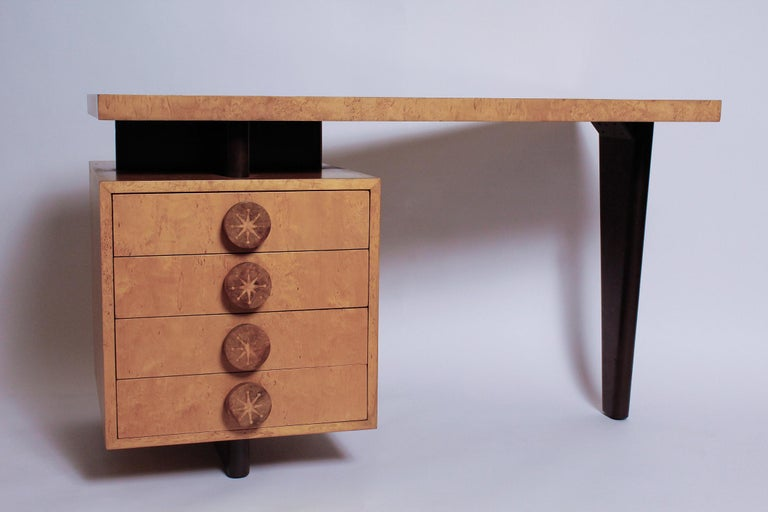 Striking, finely crafted bird's-eye maple and European walnut desk with meticulous inland star-pattern knobs and ribbon mahogany drawer interiors, by Andrew Szoeke, circa 1950.